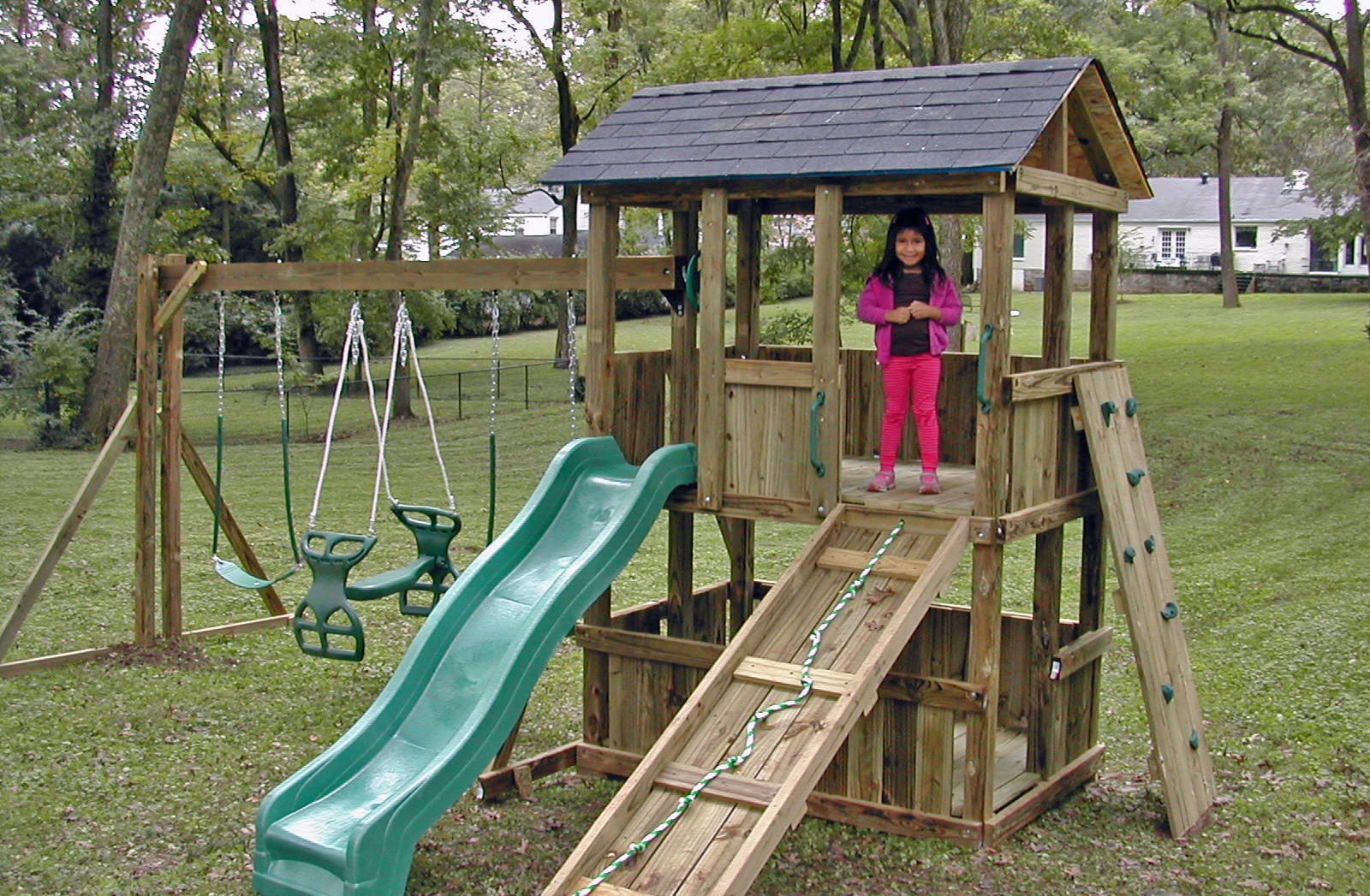 4x6 model as shown $1850 including Wooden Ramp with Rope, Green Rock Climbing Wall, Glider Horse, and Shingled Roof