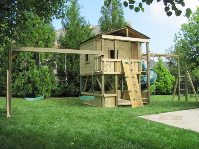 """8x8 model as shown $5175 including HOP""""s UPgrade, Lower-level Wall Boards, Shingled Roof, Enclosed Turbo Slide, Monkey Bars, Fireman's Pole, Rock Climbing Wall, Soft Grip Swings, Trapeze Bar with Rings, and Additional Window"""