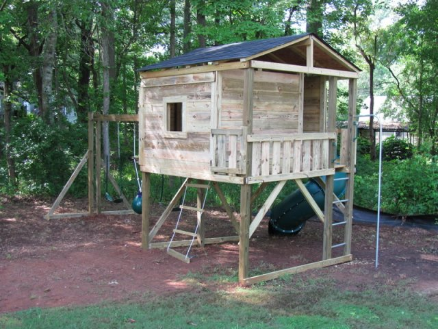 8x8 model as shown $4425 including HOP's UPgrade, Enclosed Turbo Slide, Shingled Roof, Trap Door with Rope Ladder, Fireman's Pole, Soft Grip Swings, and Buoy Ball
