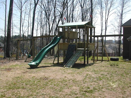 4x8 model as shown $3550 including Swingbeam, Buoy Ball, Trapeze Bar with Rings, Wooden Ramp with Rope, Grey Rock Climbing Wall, Monkey Bars, and Tire Swing