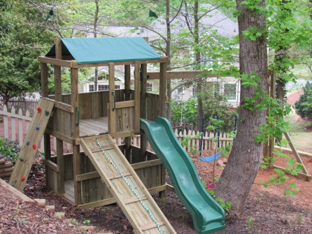 4x6 model as shown $1550 including Wooden Ramp with Rope, Rock Climbing Wall, and Soft Grip Swings