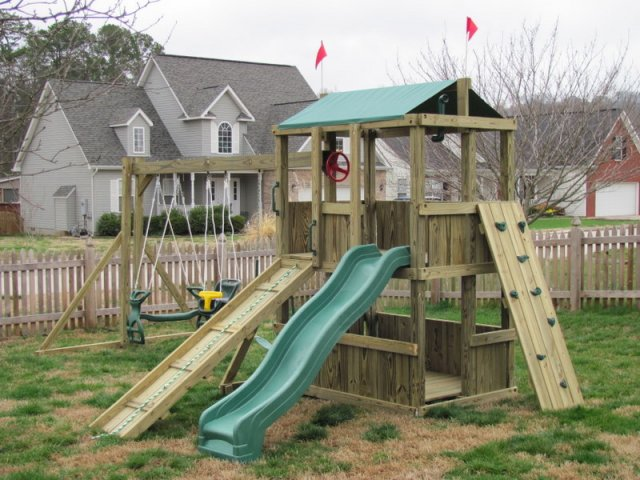 4x6 model as shown $1575 including Wooden Ramp with Rope, Rock Climbing Wall, Soft Grip Swing, Childseat, and Glider Horse