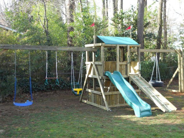 4x6 model as shown $1675 including Wooden Ramp with Rope, Childseat, Soft Grip Swings, Trapeze Bar with Rings, and Tire Swing