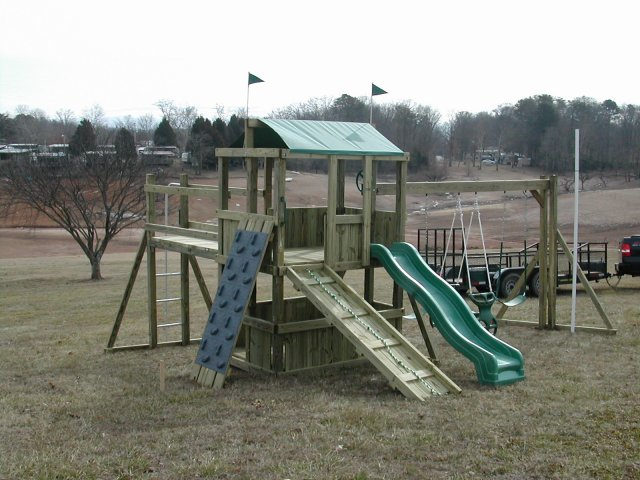 4x6 model as shown $1850 including Soft Grip Swings, Glider Horse, Wooden Ramp with Rope, Grey Rock Climbing Wall, Fireman's Pole, and Wooden Bridge