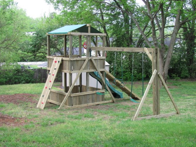 "6x6 model as shown $1995 including HOP""s UPgrade, Wooden Ramp with Rope, Red Rock Climbing Wall, Soft Grip Swings, and Traepze Bar"