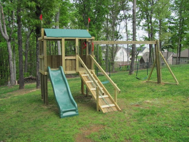 4x6 model as shown $1150 including Wooden Ramp with Handrails, 2 Soft Grip Swings, and Trapeze Bar with Rings