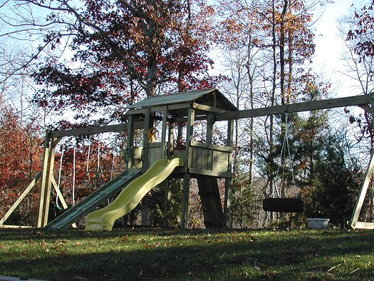 4x6 model as shown $1650 including Wooden Ramp with Rope, Wooden Roof, Grey Rock Climbing Wall, and Tire Swing