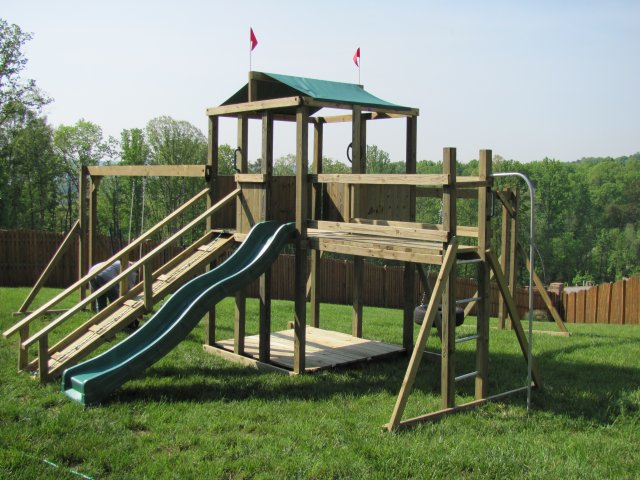 6xt model as shown $2100 including HOP's UPgrade, Ramp with Rope and Handrails, Covered Bottom, Tire Swing, Wooden Bridge, Fireman's Pole, and Soft Grip Swings