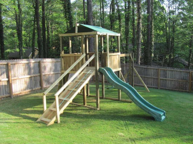 6x6 model as shown $1625.00 including HOP's UPgrade, Wooden Ramp with Rope and Handrails, Periscope, Slide Repositioning, 2 Soft Grip Swings, and Trapeze Bar with Rings