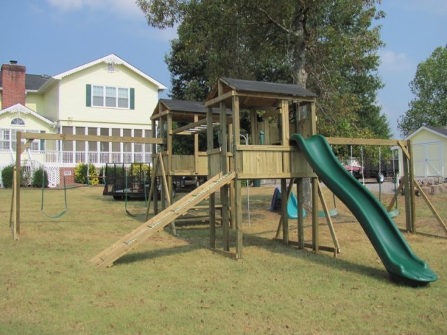 4x6 Eagle's Nest and 4x6 Jungle House models as shown $4300 including HOP's UPgrade, 13' Wave Slide, Shingled Roofs, Picnic Table, Wooden Ramp with Rope, Fireman's Pole, Soft Grip Swings, Trapeze Bar with Rings, and Monkey Bars