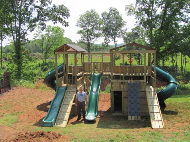 8x8 Mammoth and 4x8 Eagl's Nest models as shown $9550 including 10' Wave Slide, Enclosed Turbo Slides, 13' Wave Slide, Shingled Roofs, Tire Swing, Soft Grip Swings, Trapeze Bar with Rings, Rock Climbing Wall, Wooden Bridge with Wall Boards, and more