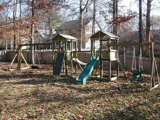2 4x4 Jungle House models $2975 grey rock,sandbox,tire swing,glider horse trapeze,rope ladder,wood roofs, SOLID BRIDGE,,swinging rope bridge no longer available.