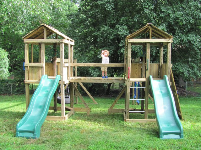 2 4x4 Jungle House models as shown $2495 including Wooden Bridge, Wooden Roofs, Tire Swing, Soft Grip Swings, Trapeze Bar with Rings, and Rock Climbing Wall